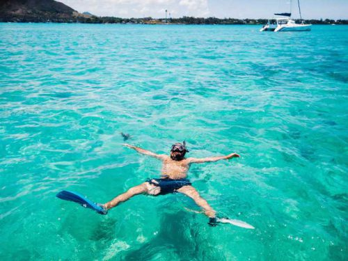 800- Mauritius - a-guy-in-fins-and-a-mask-swims-in-a-lagoon-on-the-island-of-mauritius