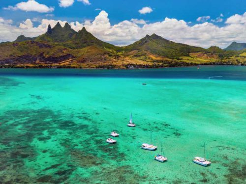 800 - Mauritius - aerial-picture-of-the-east-coast-of-mauritius-island-beautiful-lagoon-of-mauritius-island-shot-from-above-boat-sailing-in-turquoise-lagoon